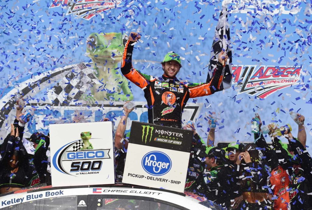 Chase Elliott celebrates in victory lane after winning the GEICO 500 at Talladega Superspeedway.