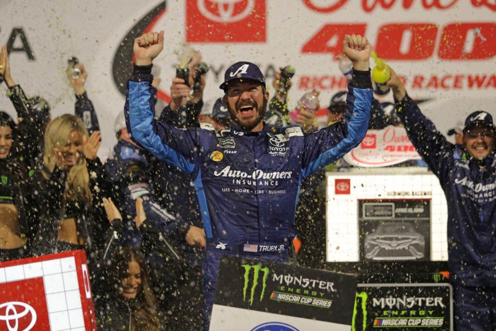 Martin Truex Jr. celebrates in victory lane after winning the Toyota Owners 400 at Richmond Raceway Saturday night.