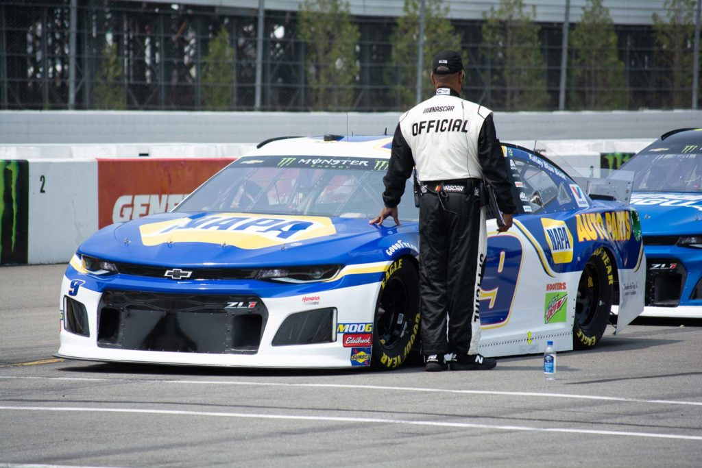 Chase Elliott awaits on the grid for qualifying for the Pocono 400