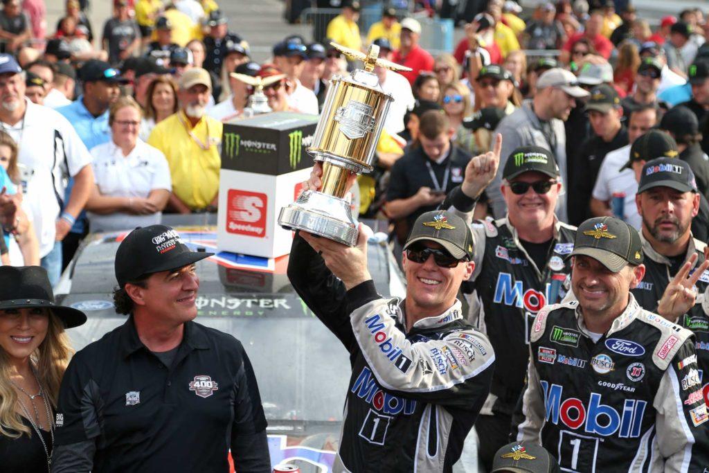 Kevin Harvick celebrates after winning the Brickyard 400