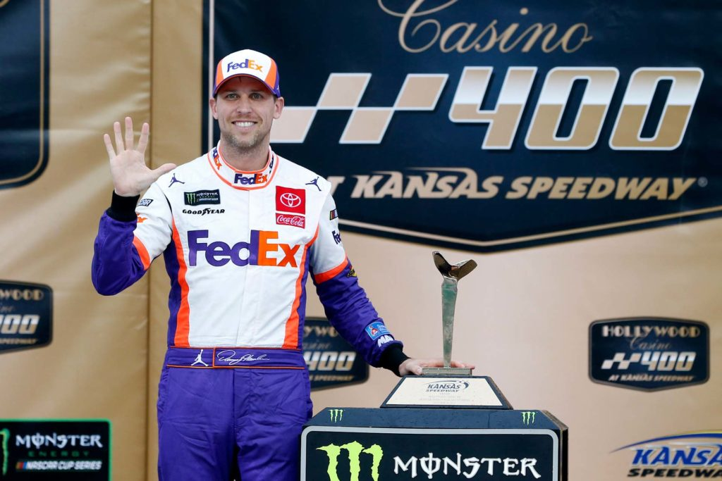 Denny Hamlin celebrates after winning the Hollywood Casino 400 at Kansas Speedway