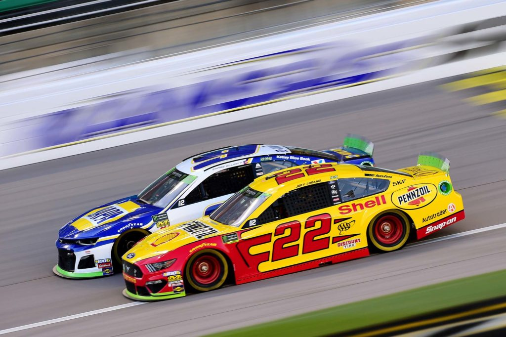 Joey Logano and Chase Elliott battle side-by-side during the Hollywood Casino 400.