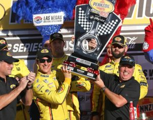 Joey Logano celebrates in victory lane after winning the Pennzoil 400