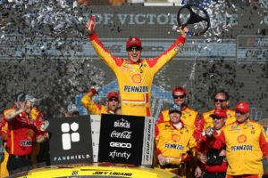 Joey Logano celebrates after winning the FanShield 500 at Phoenix Raceway