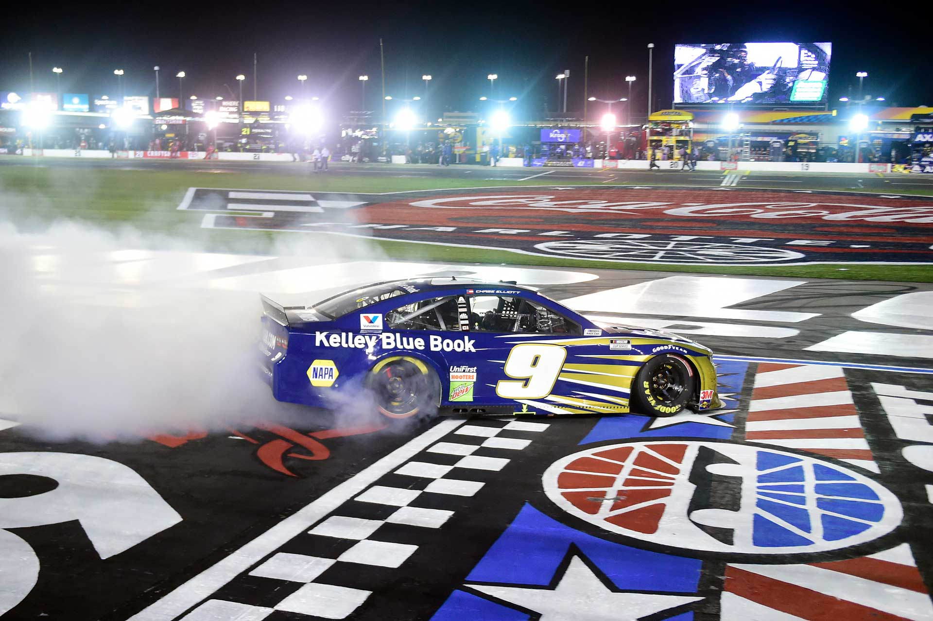 Chase Elliott celebrates after winning the Alsco Uniforms 500 at Charlotte Motor Speedway.