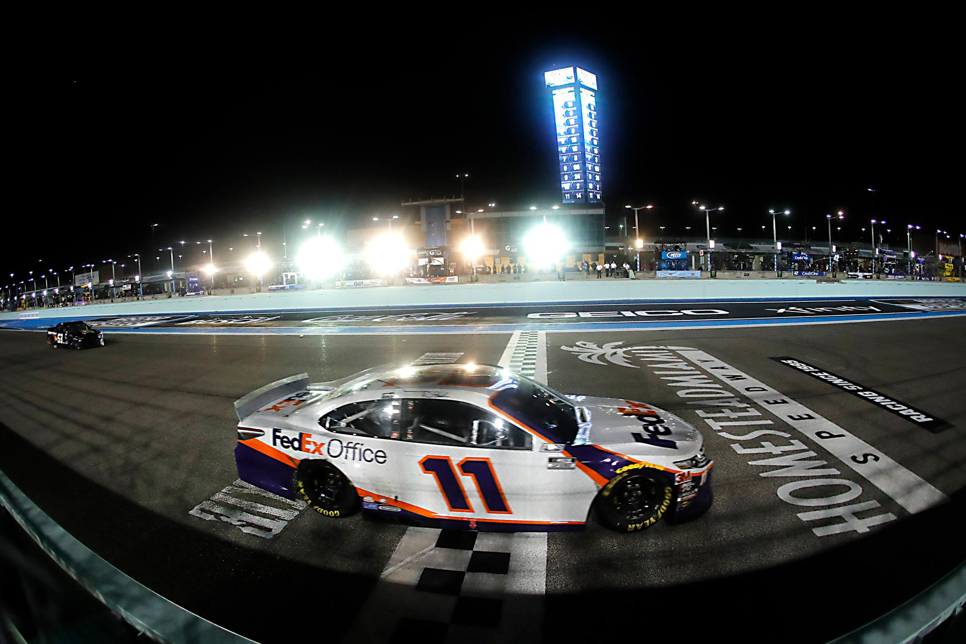 Denny Hamlin takes the checkered flag to win the Dixie Vodka 400.