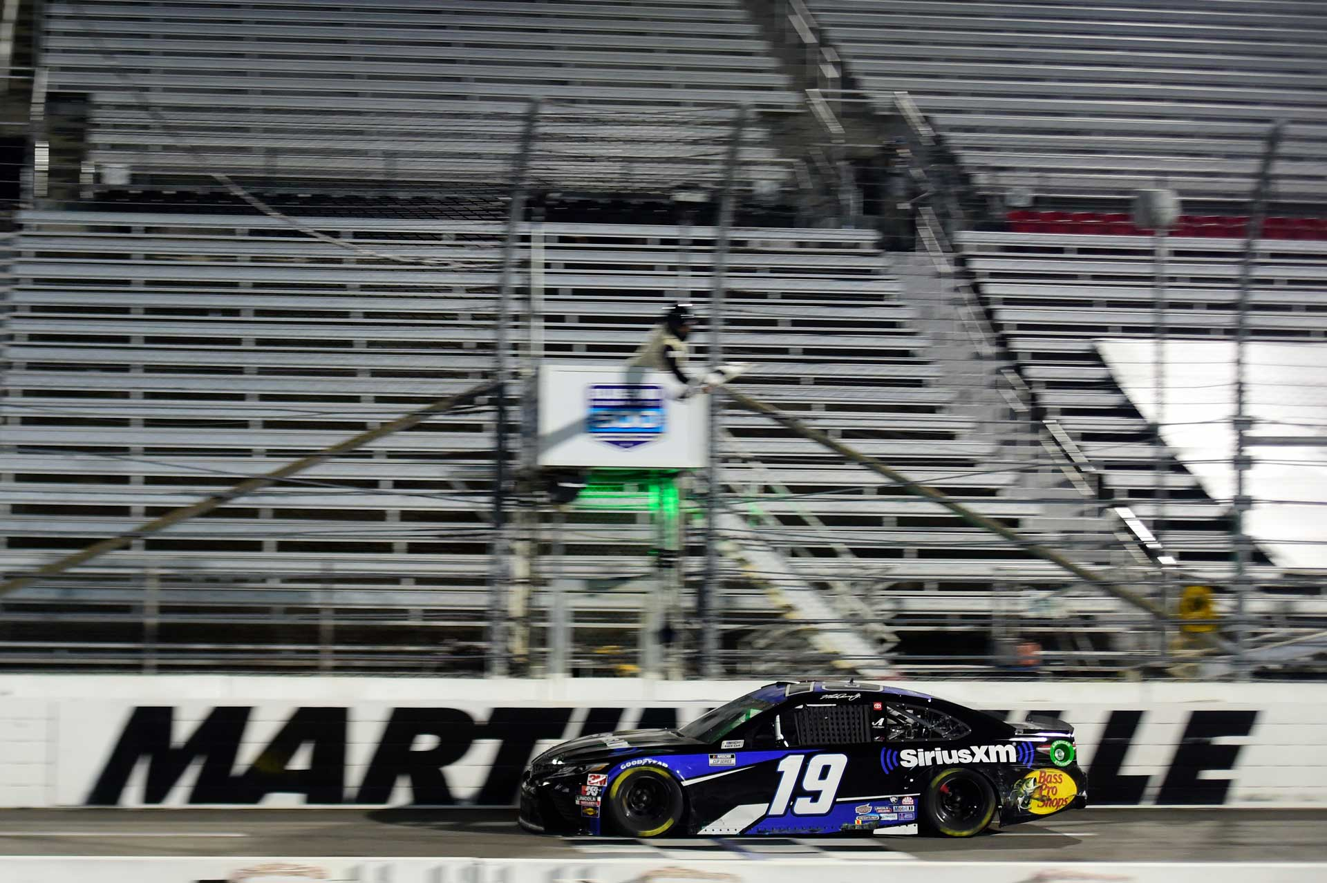 Martin Truex Jr. takes the checkered flag to win the Blu-Emu Maxiumum Pain Relief 500 in Martinsville.