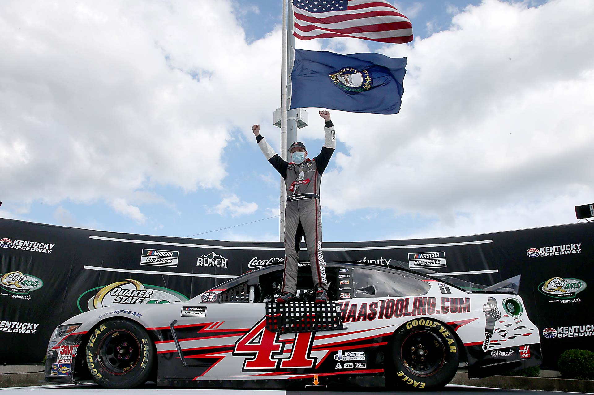 Cole Custer celebrates after winning the Quaker State 400