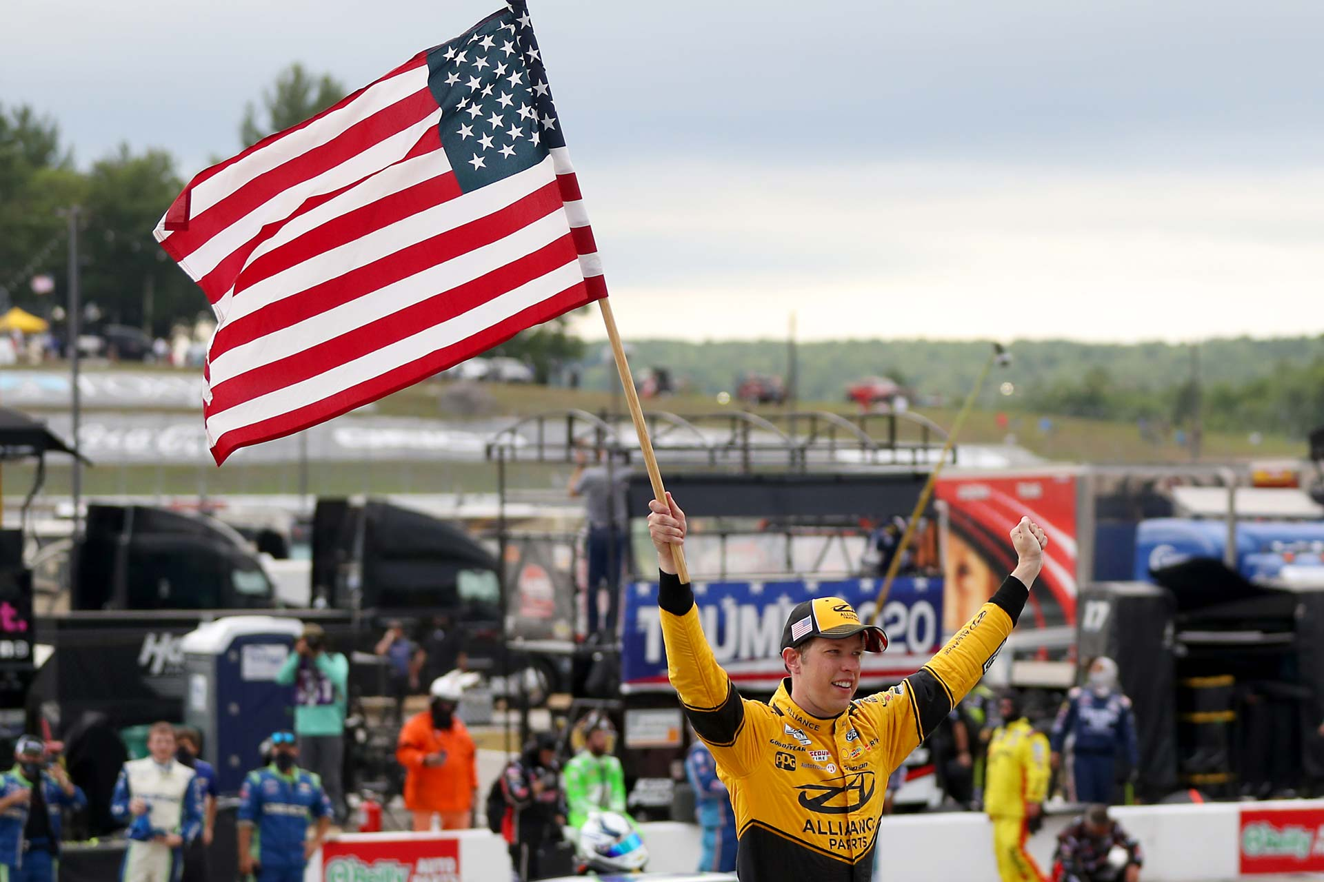 Brad Keselowski celebrates with the fans after winning the Foxwoods Resort Casino 301 in New Hampshire